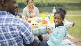 Family eating at picnic table