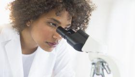 USA, New Jersey, Jersey City, Woman using microscope in laboratory