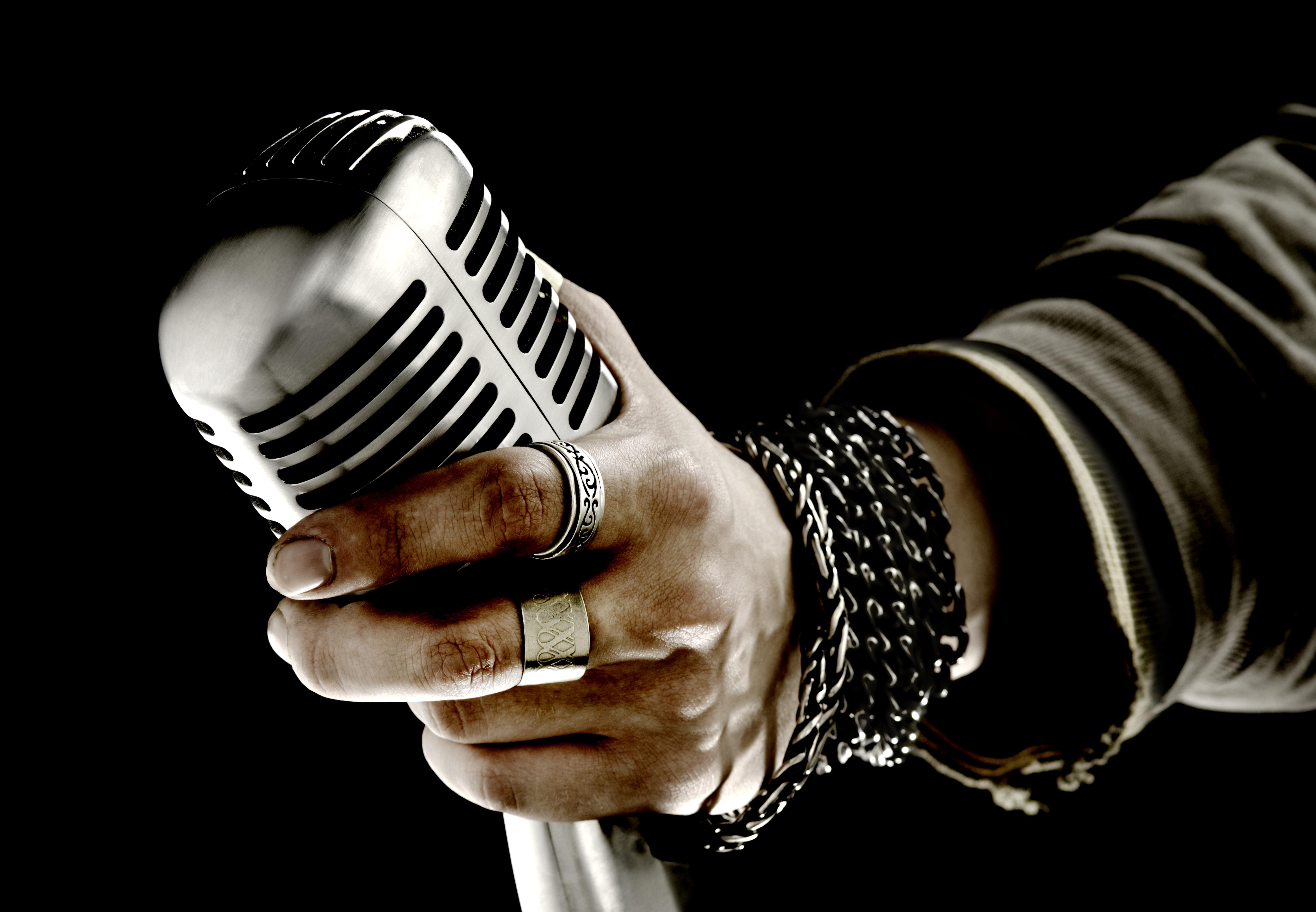Man holding microphone, close-up