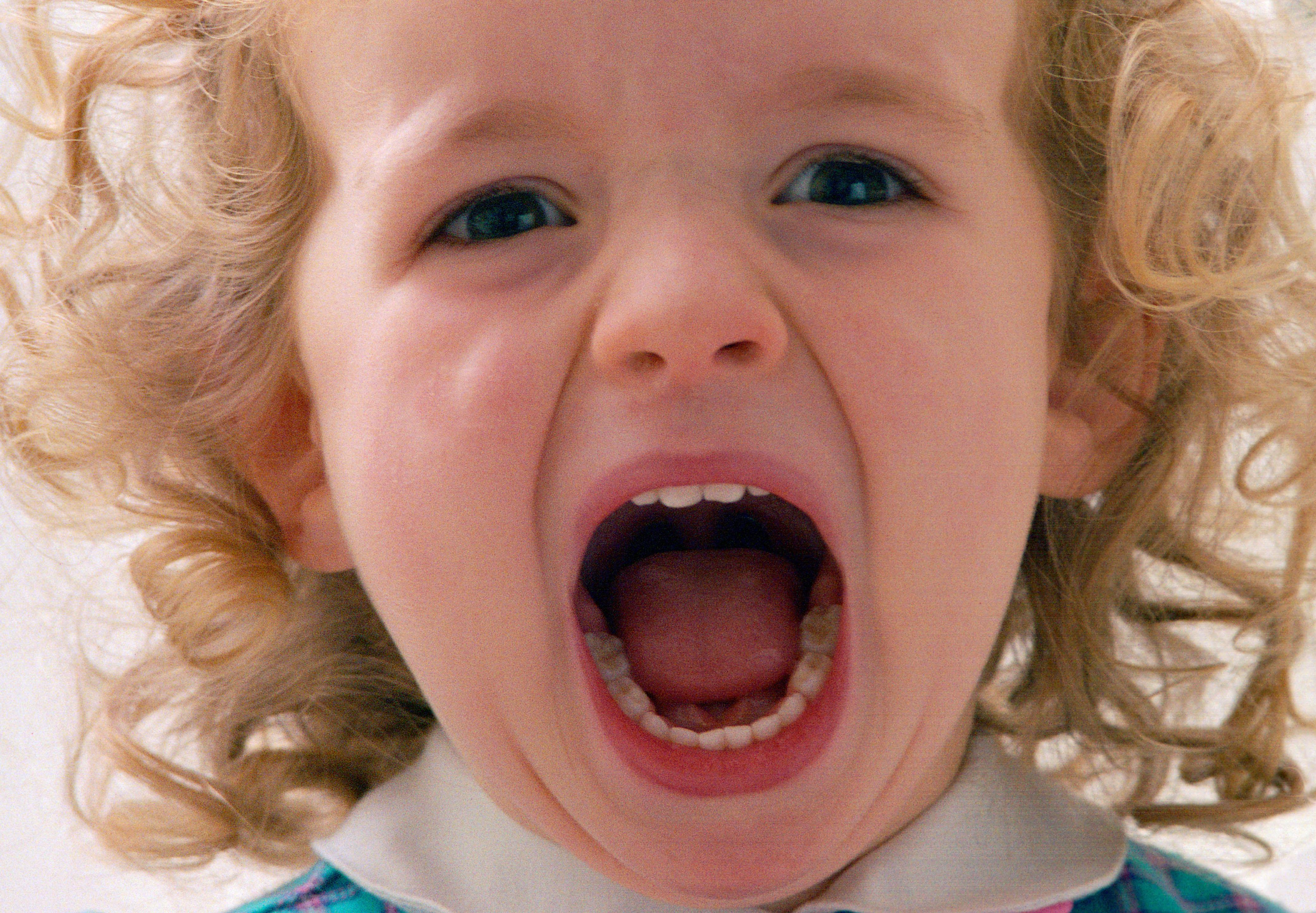 A two year old girl shouting