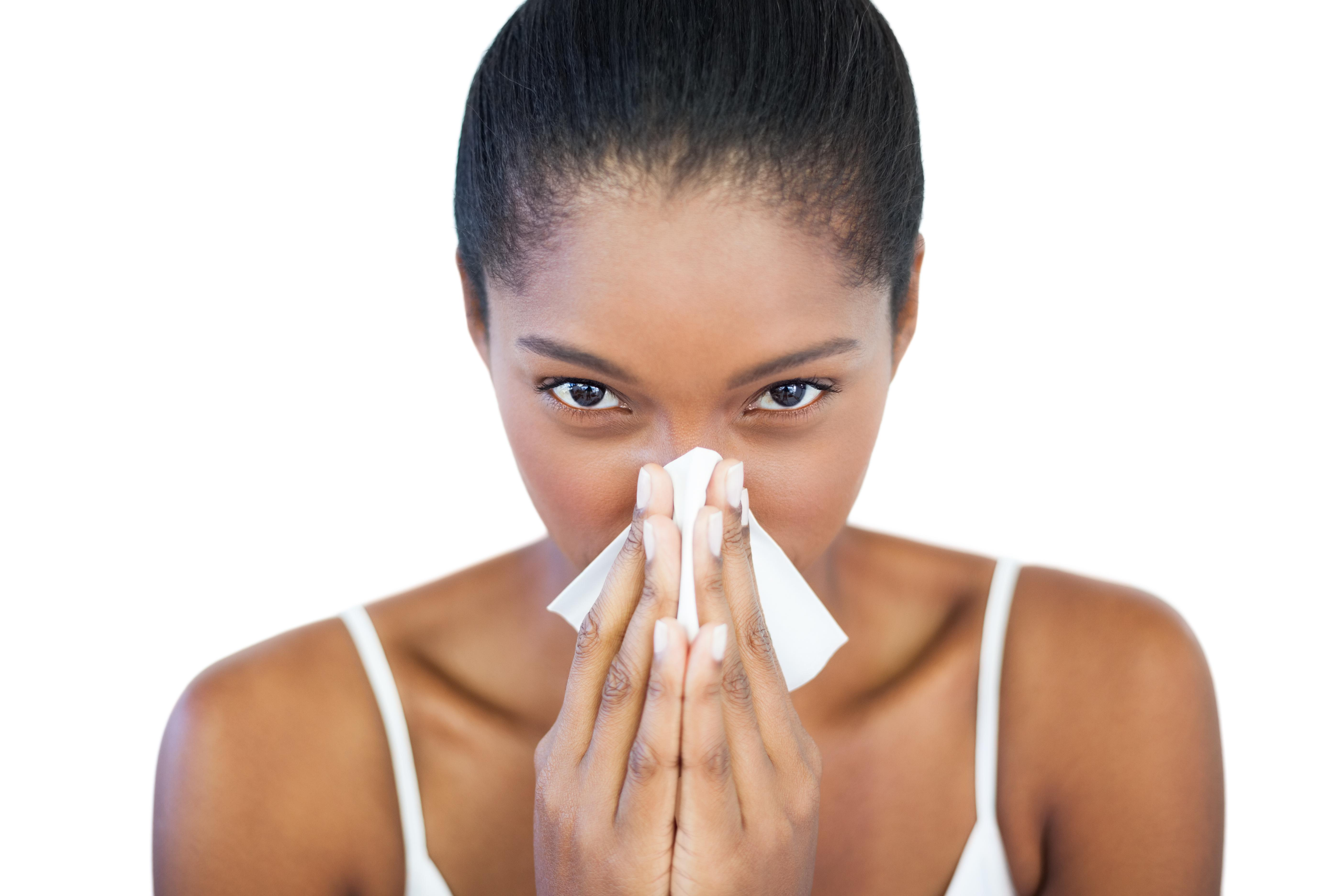 Serious woman has a cold on white background