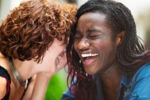 Laughing mixed race girlfriends