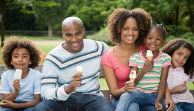 Family in park with ice creams