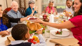 Holidays: Family, friends gather for dinner at senior woman's home.