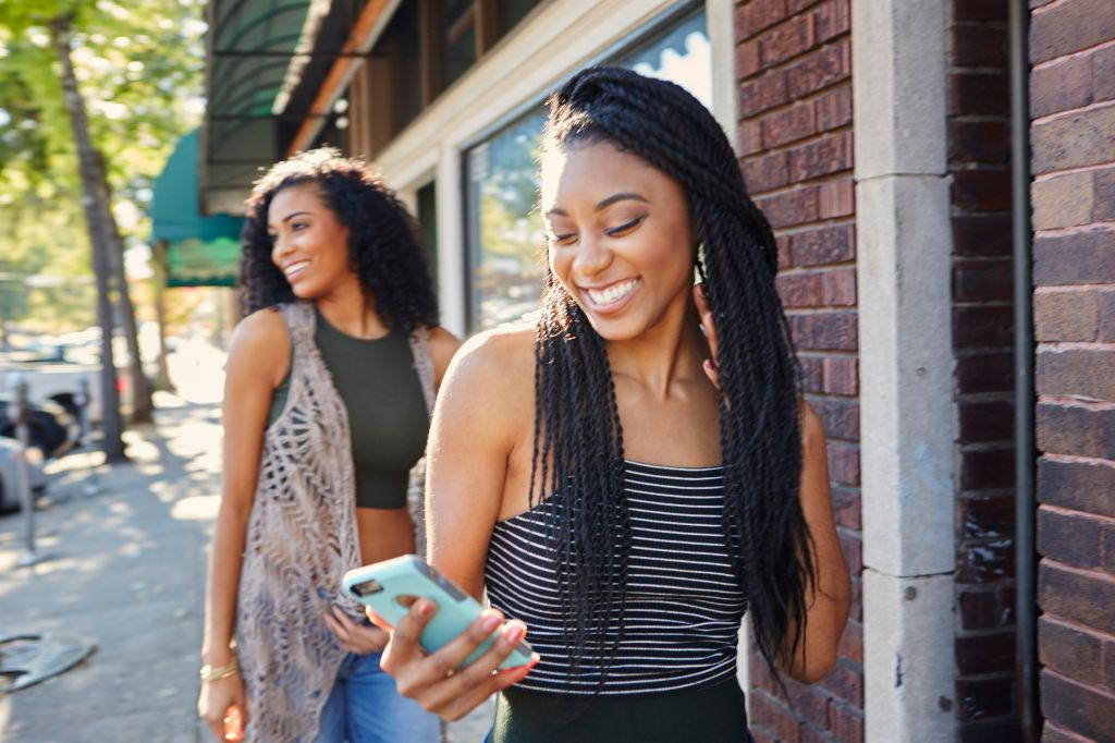 Young women explore a city