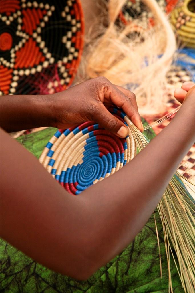 African women demonstrating basket weaving, International Folk Art Market, Santa Fe, New Mexico, USA