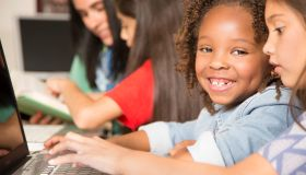 Elementary-age children learn computer coding in school.
