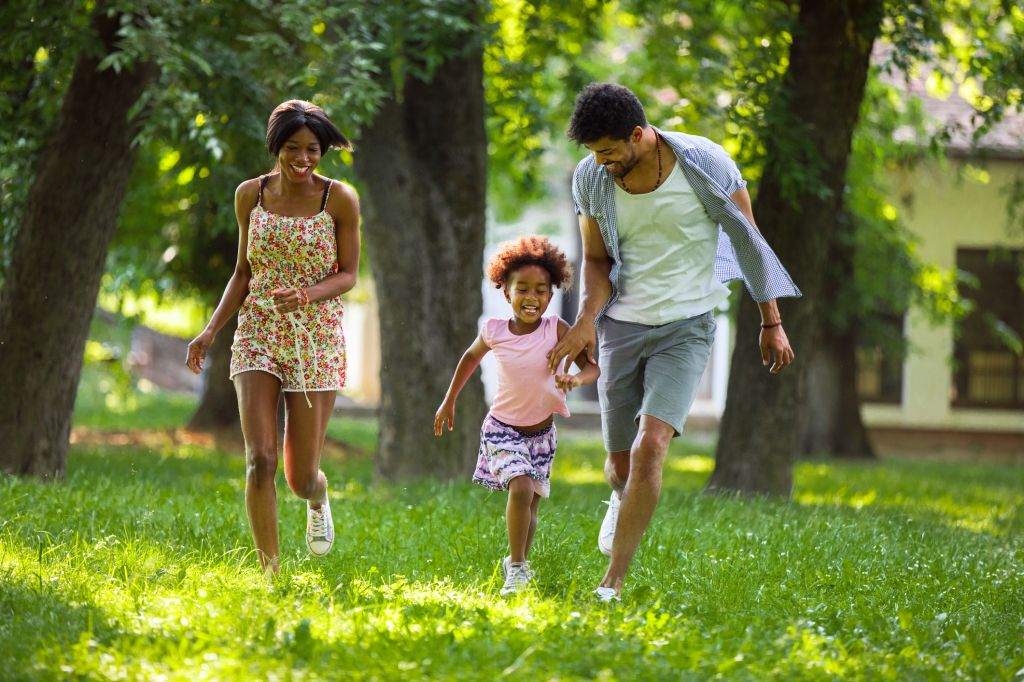 Playful family running in the park