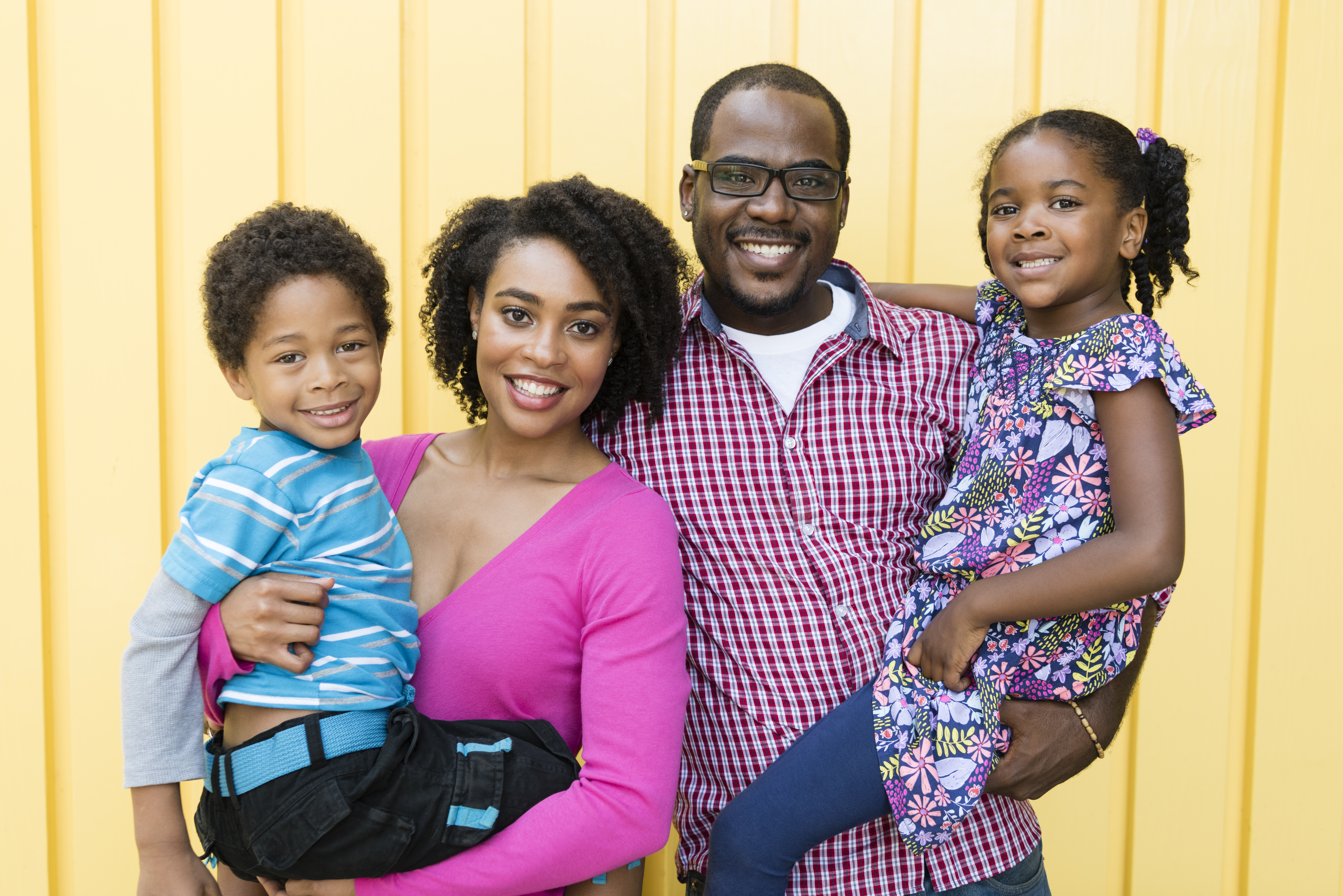 African American family smiling to the camera, portrait