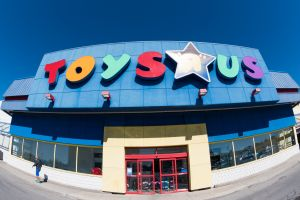 Toys R Us store facade in daytime. Toys 'R' Us, Inc. is an...