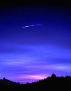 Meteor Flying Through a Darkened Sky
