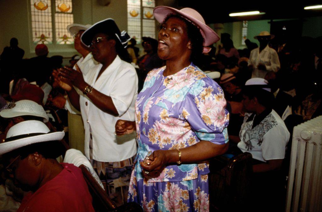Women Singing During Church Service