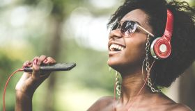 Woman Listening Music at Park