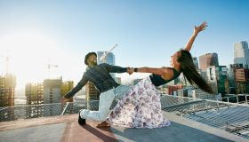 Couple dancing on urban rooftop