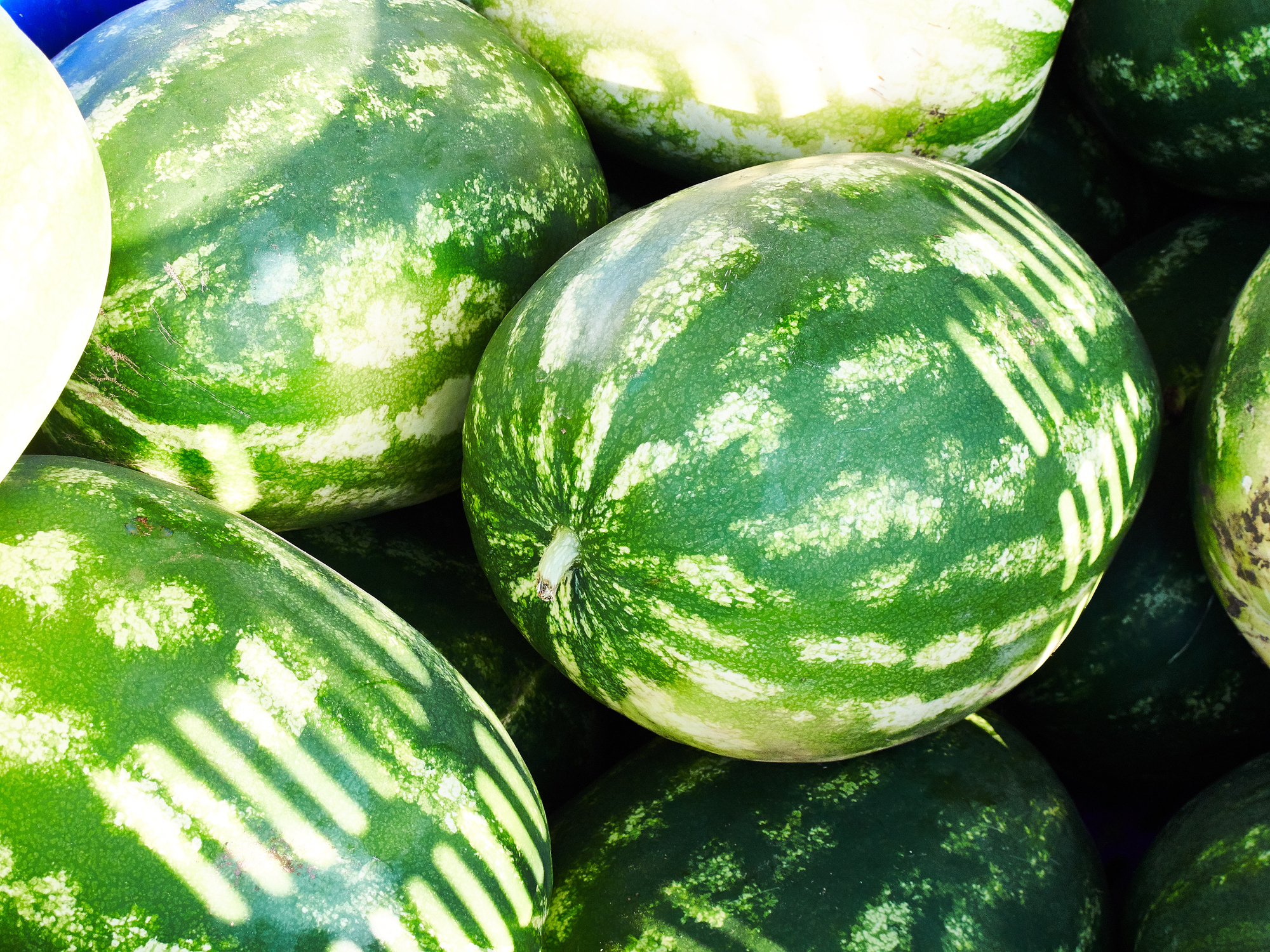 Close-Up Of Watermelons For Sale At Market