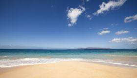 beach, ocean and clounds on tropical island.