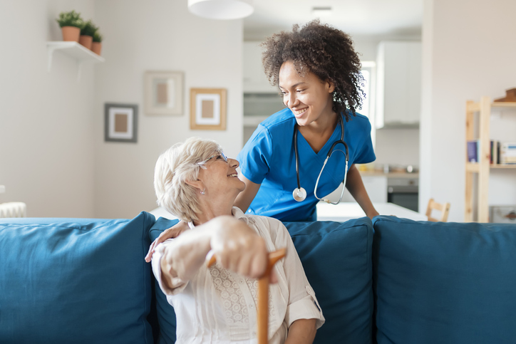 Portrait of Smiling Senior Woman and Her Mixed Race Female Caregiver
