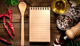 Blank recipe book with herbs and spices