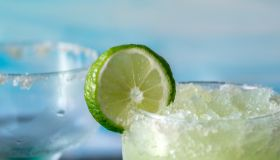 Cold And Icy Frozen Margarita Drinks With Slices Of Lime