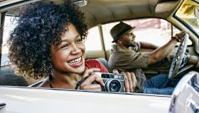 Couple driving in vintage car