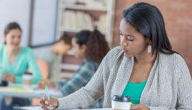 College student concentrates while studying in the student center