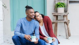 African-American couple hanging out, drinking coffee