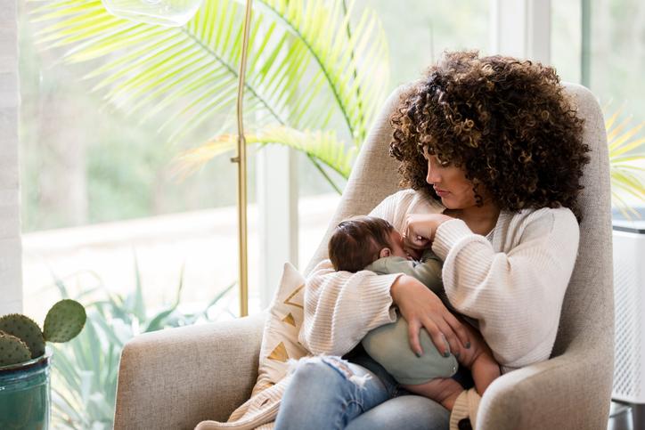 Mom nurses newborn son
