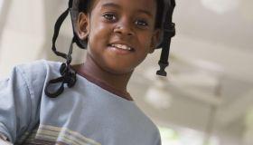 Smiling boy wearing a helmet