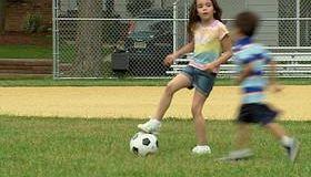 MS Boy and girl playing soccer on baseball diamond/ Fanwood, New Jersey