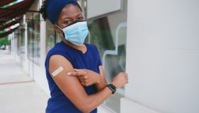 Woman Smiles Outdoors After Receiving COVID-19 Vaccine
